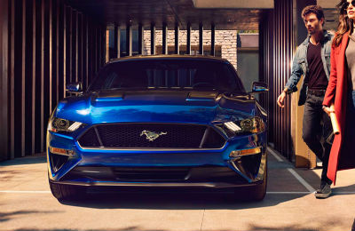 2018 Ford Mustang front fascia with couple walking on the side