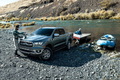 2019 Ford Ranger exterior front fascia and drivers side backed into water with two men and kayak