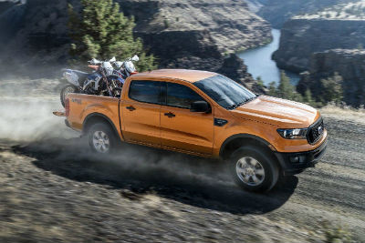 2019 Ford Ranger exterior front fascia and passenger side driving off road