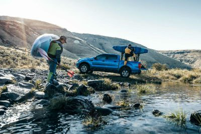 2019 Ford Ranger exterior passenger side profile with 2 men and kayaks