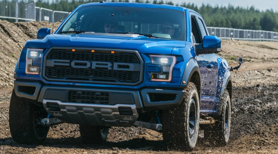 blue 2017 Ford F-150 Raptor driving off-road