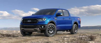 Blue Lightning color 2019 Ford Ranger exterior front fascia and drivers side parked in wilderness