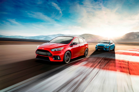 Red and blue 2018 limited edition Ford Focus RS models driving on test track