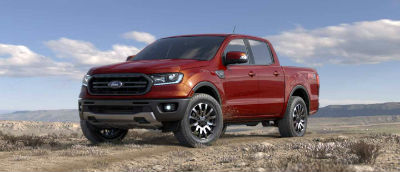 Hot Pepper color 2019 Ford Ranger exterior front fascia and drivers side parked in wilderness