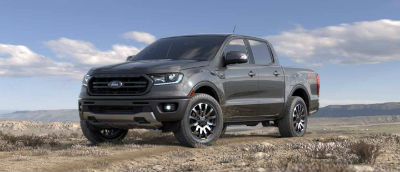 Magnetic color 2019 Ford Ranger exterior front fascia and drivers side parked in wilderness