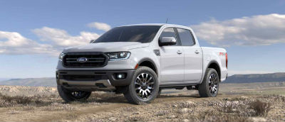 Oxford White color 2019 Ford Ranger exterior front fascia and drivers side parked in wilderness