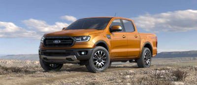 Saber color 2019 Ford Ranger exterior front fascia and drivers side parked in wilderness
