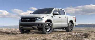 White Platinum color 2019 Ford Ranger exterior front fascia and drivers side parked in wilderness