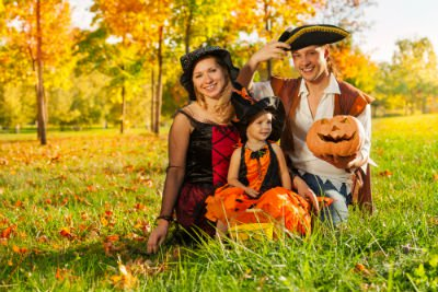 family in Halloween costume outside
