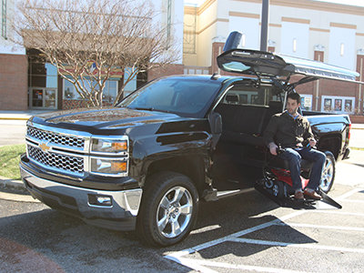 man using atc truck conversion in parking lot