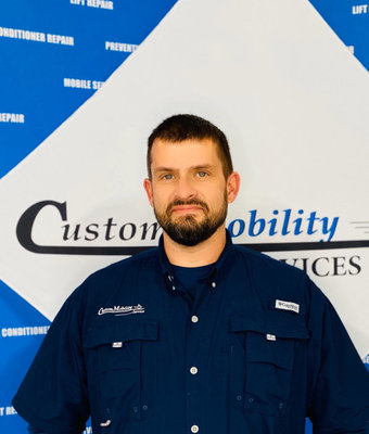 Mobile Tech. Manager Eric Davis in Mobile Service at Custom Mobility