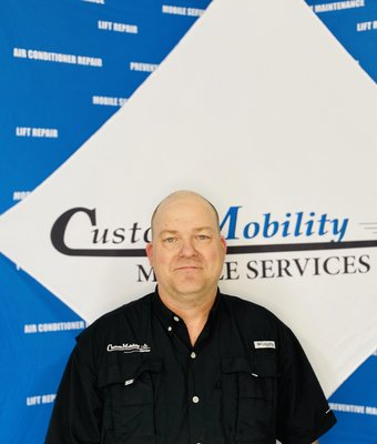 Service Technician Bobby Nix in Service at Custom Mobility