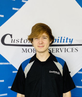 Shop Technician Intern Spencer Morgan in Service at Custom Mobility