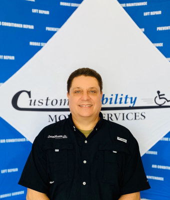 Service Manager Kirk Fordham in Service at Custom Mobility