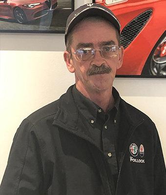 "Vehicle Transport Edward ""Dok"" Doknovitch in Service at Ken Pollock Alfa Romeo"
