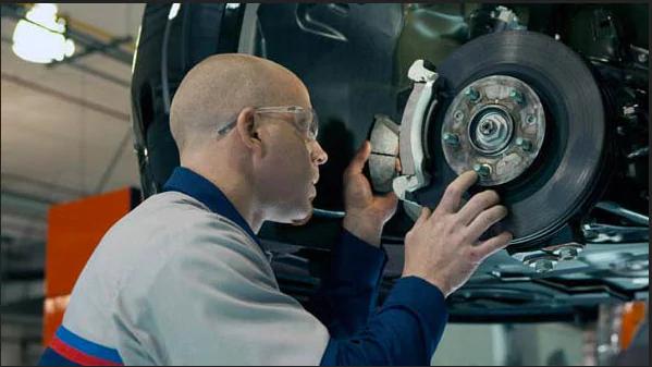 Certified Man Fixing Brakes