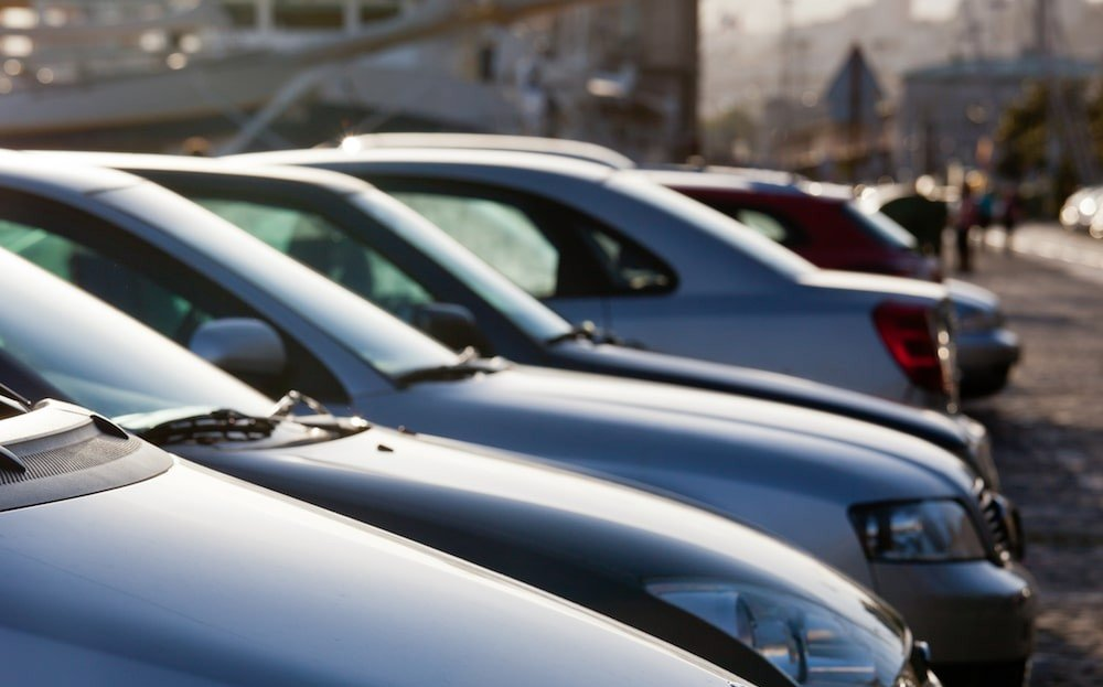 Line of parked used cars for sale