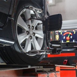 A Tire receiving Nissan Alignment Service in Orlando.