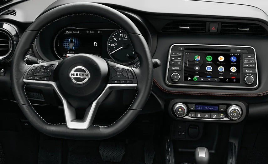 A view from the driver's seat of a Nissan, with the Android Auto interface on the center display