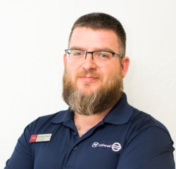 Service Advisor Tim Tyron in Service at Universal Nissan