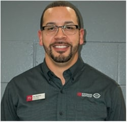 Quick Lube Manager Jay Gerena in Service at Universal Nissan