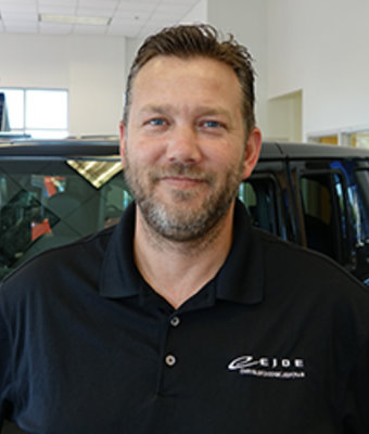 Business Manager Troy Westrum in Management at Eide CDJR Pine City