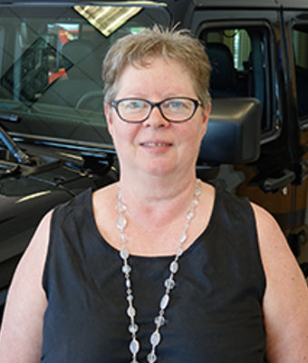 Office Staff Donna Sheehan in Office at Eide CDJR Pine City