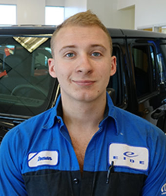 Lube Technician Roman Kupfer in Service at Eide CDJR Pine City
