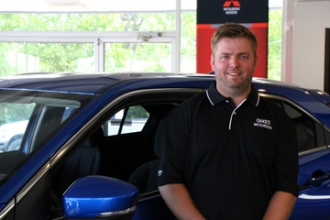 Porter Curtis Wells in Oakes Mitsubishi Team at Oakes Auto