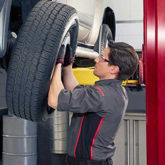 technician installing tires
