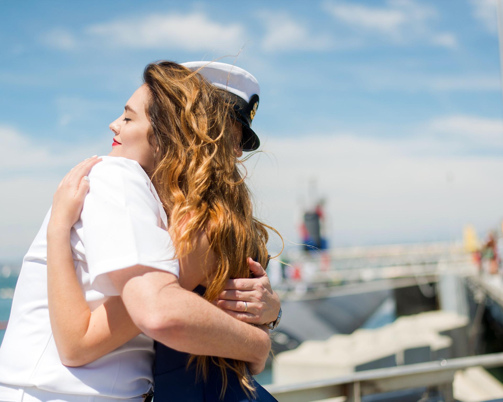 naval sailor embracing wife