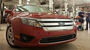 red certified used ford fusion that has passed inspection